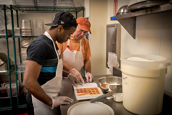Shaquille Brown in the Community Kitchen with Scott Roubeck