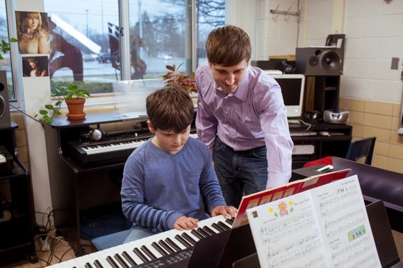 Piano Labs Instructor Hugh Little with Woods Lake Elementary School Student
