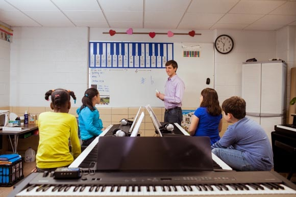 Piano Labs Instructor Hugh Little with Woods Lake Elementary School Students